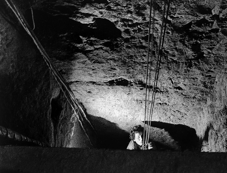 An escapee being hoisted up the final 12 meters to freedom in West Germany.