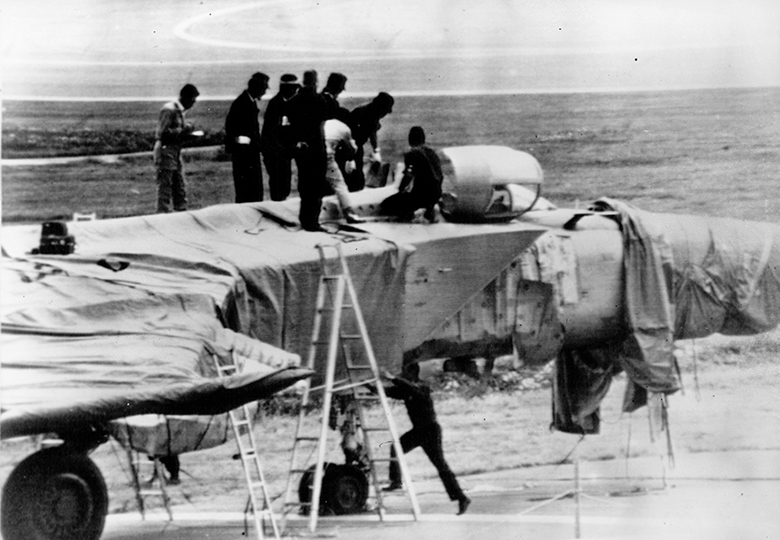 Japanese officials, wary of booby traps, cautiously examine the MiG on September 7, 1976