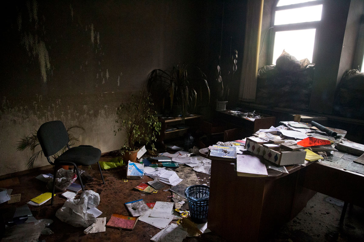 """The interior of the security service building in Slovyansk on July 7, 2014, two days after Igor Girkin and his Russia-backed militants retreated from the city, leaving behind the """"tribunal"""" documents."""
